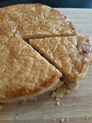Galette des rois with one slice cut