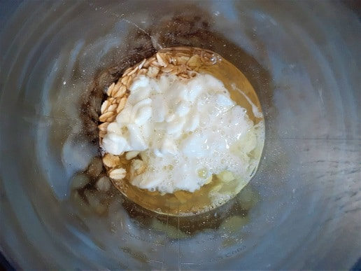 Egg whites, oats and cottage cheese in a cup before blending.