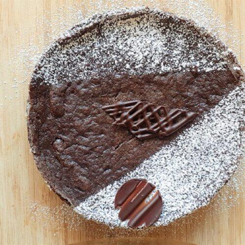 Vegan gooey chocolate cake on wooden board