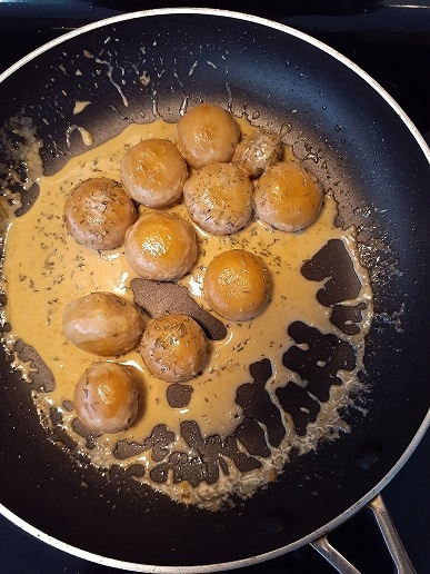 Creamy mushrooms in a frying pan