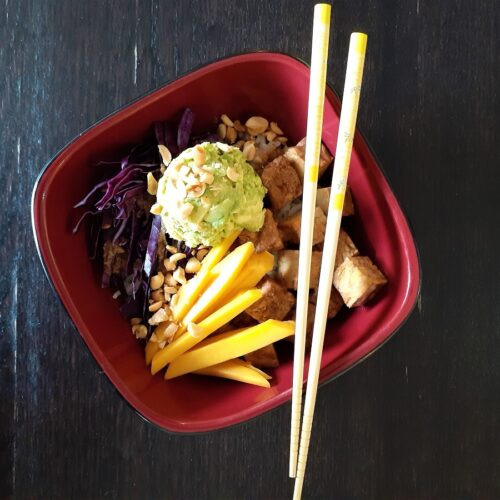 Vegan poke bowl with chopsticks