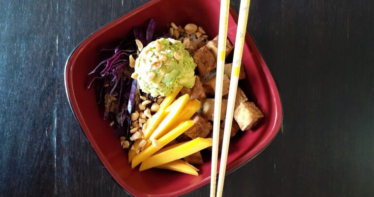 Vegan poke bowl with chopsticks