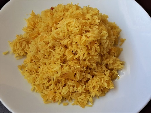 Turmeric rice in a plate