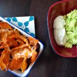 Vegetarian nachos with guacamole and sour cream