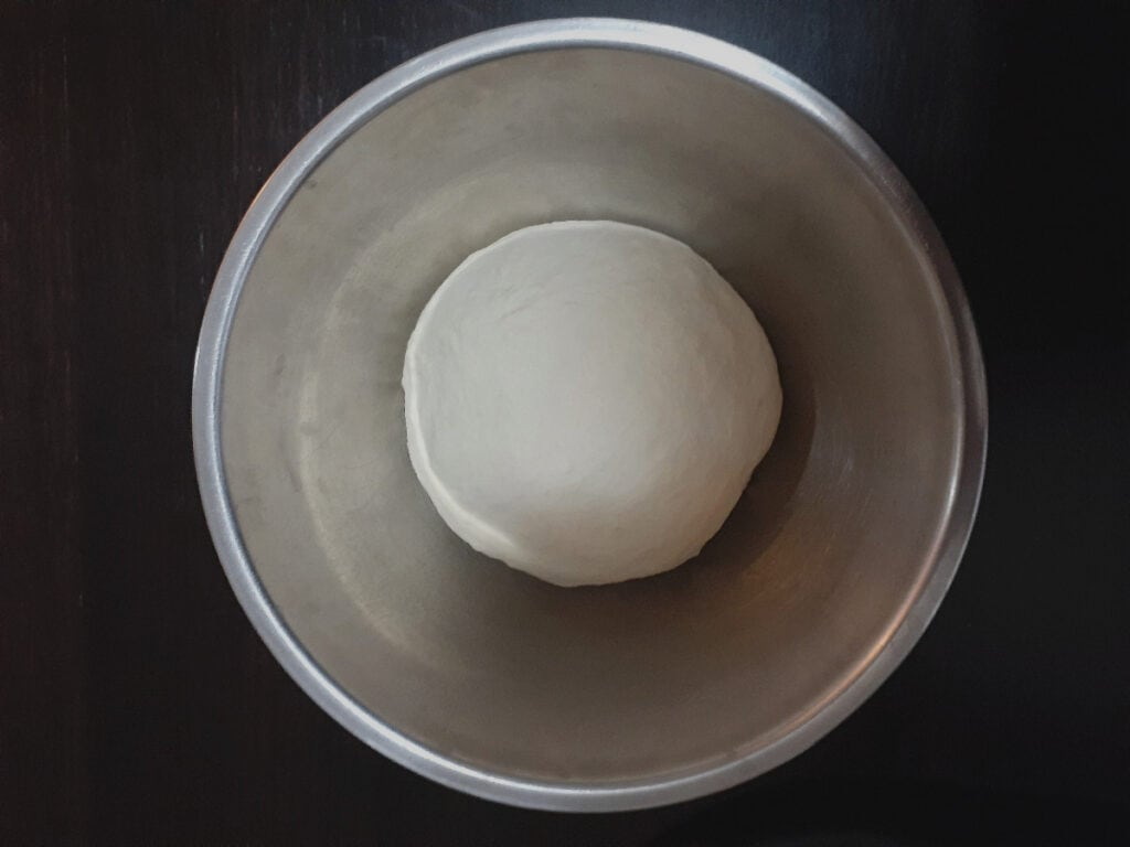 Pizza dough in a bowl before proofing