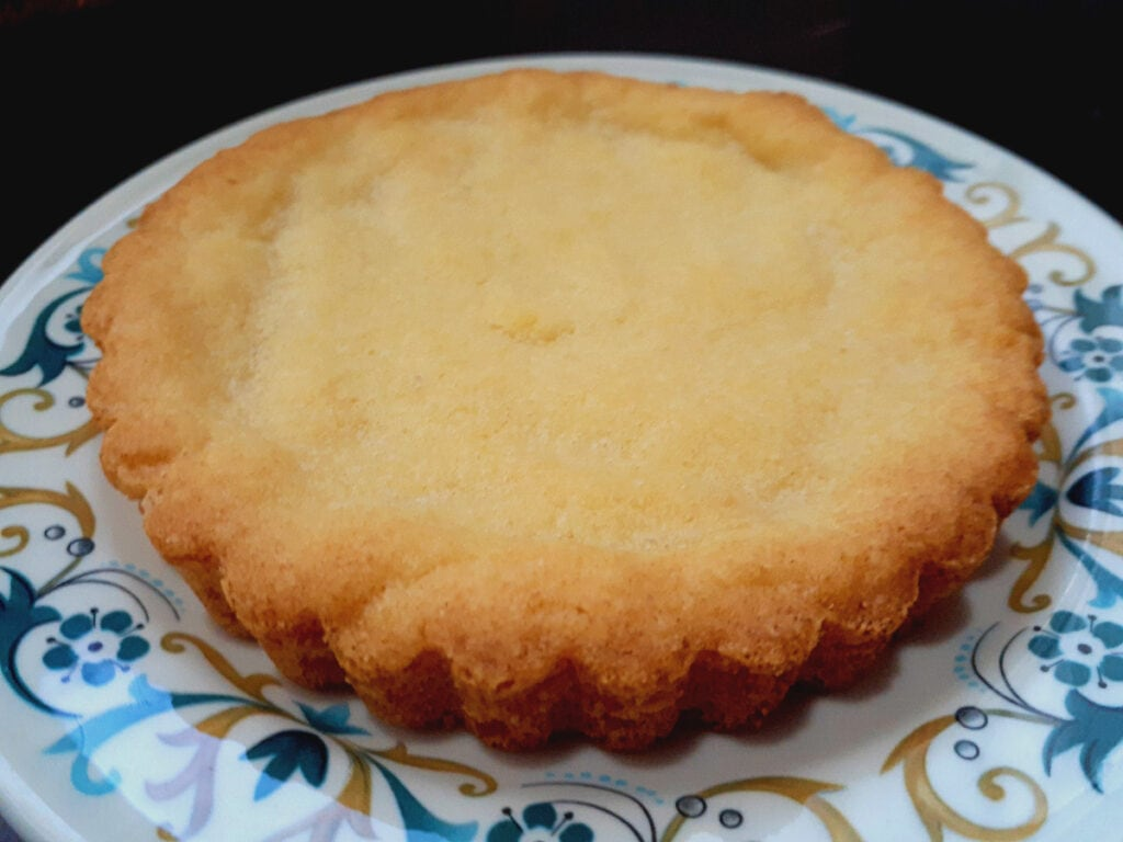 Buttery tart crust on a plate