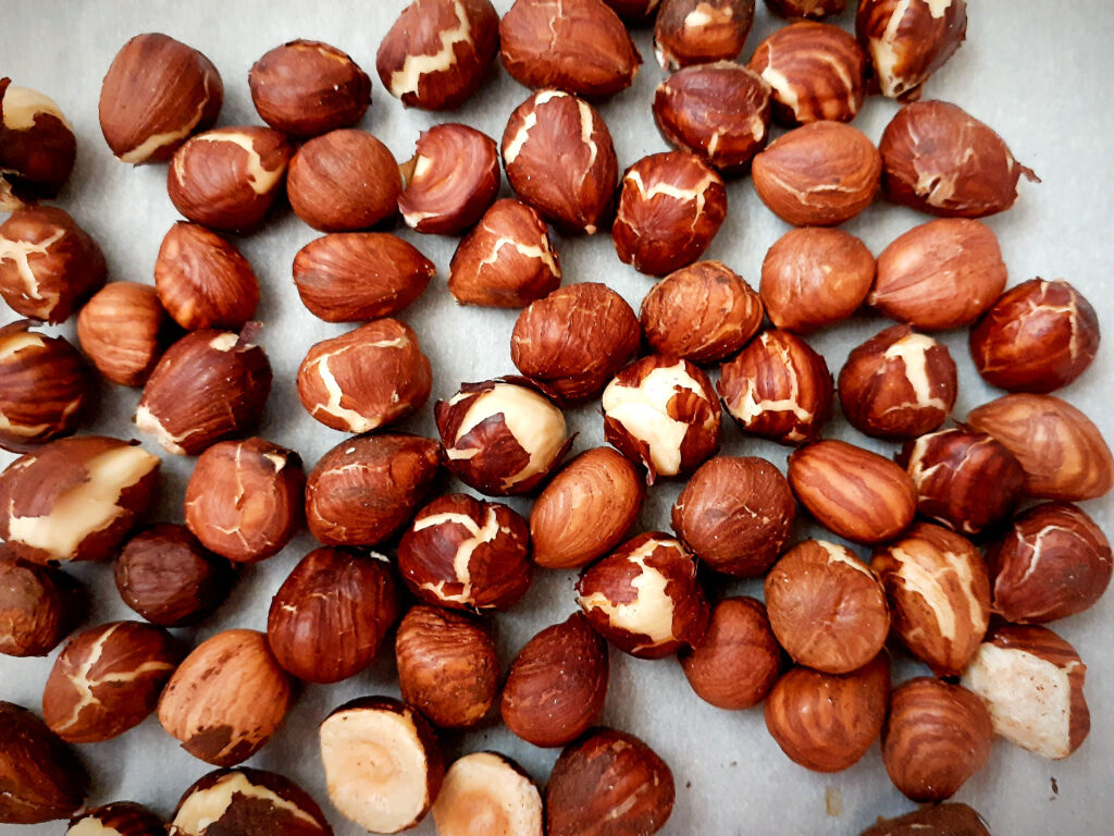 Roasted hazelnuts with the skin cracking