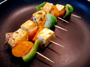 Frying vegan kabobs in a pan