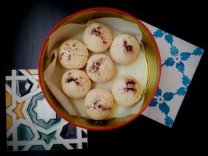 Ghoriba cookies in a metal tin container