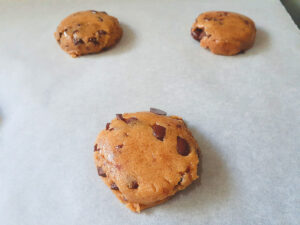 Chickpea flour cookies on parchment paper before baking