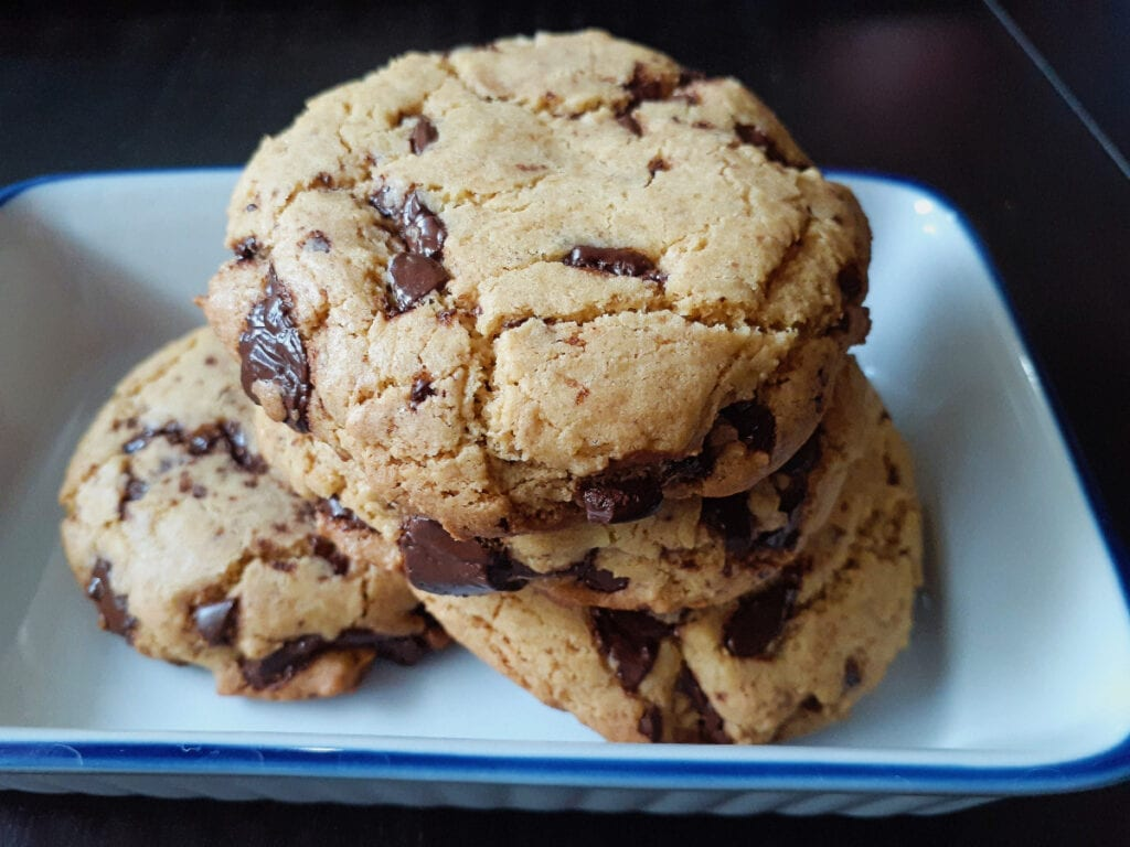 Four gluten free and vegan chickpea flour cookies in a rectangular dish