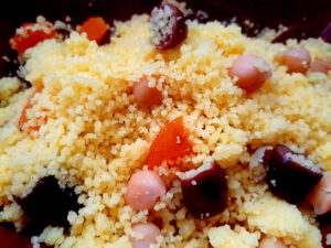 Couscous salad with olives, dried apricots and chickpeas