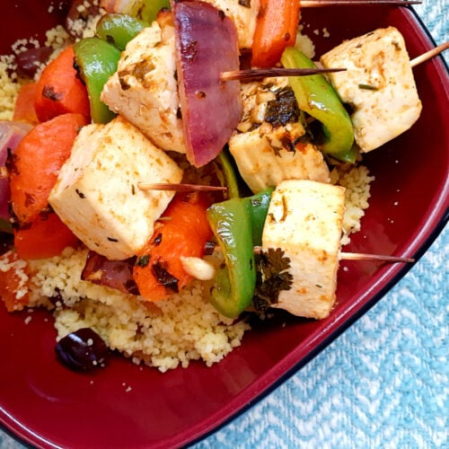 Vegetarian kobabs with couscous salad in a bowl