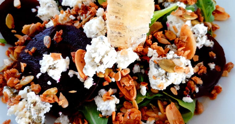 Beet, granola, honey and goat cheese salad