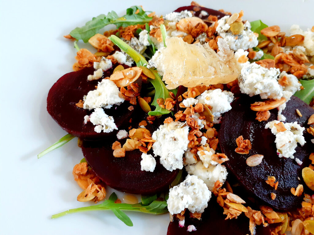 Beet, honey,granola and goat cheese salad.