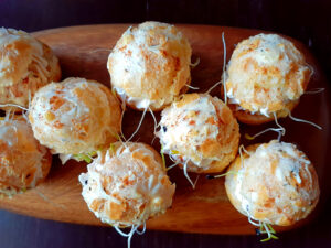 Savory profiteroles on a wooden dish