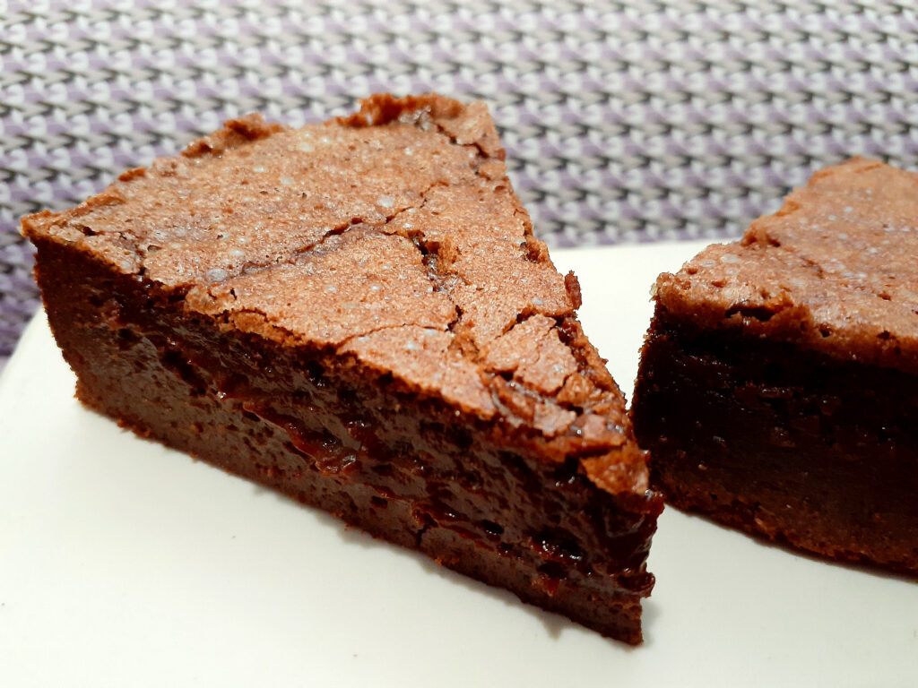 One slice and half slice of baked chocolate mousse cake
