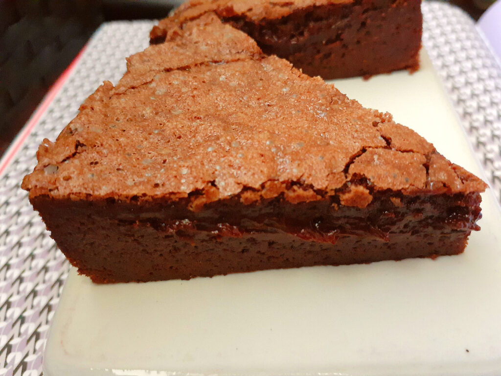 two slices of baked chocolate mousse cake