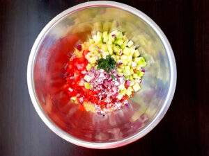 Diced vegetables and couscous in a bowl