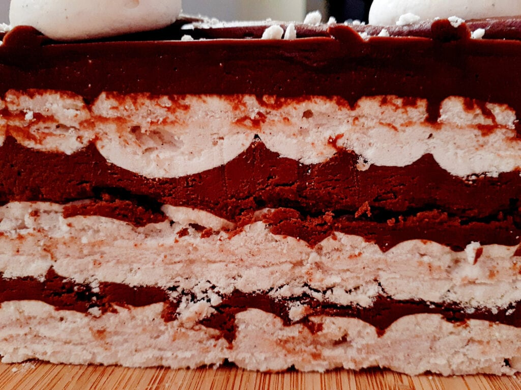 Close up on the layers of the cinnamon and meringue cake