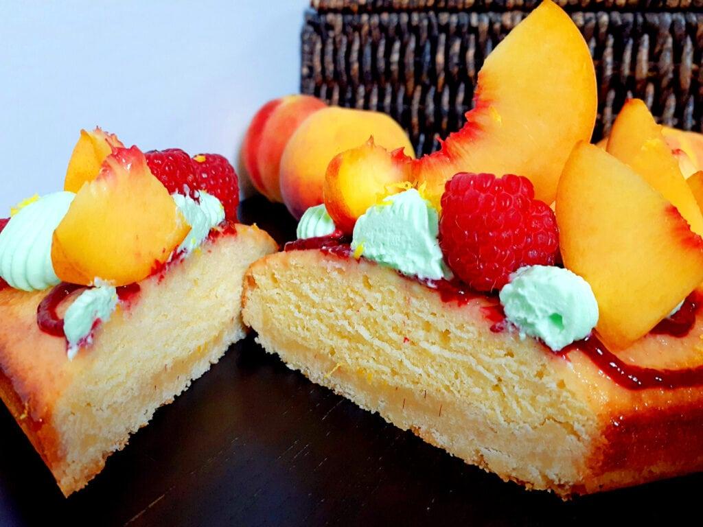 Peach, verbena and raspberry tart cut in two