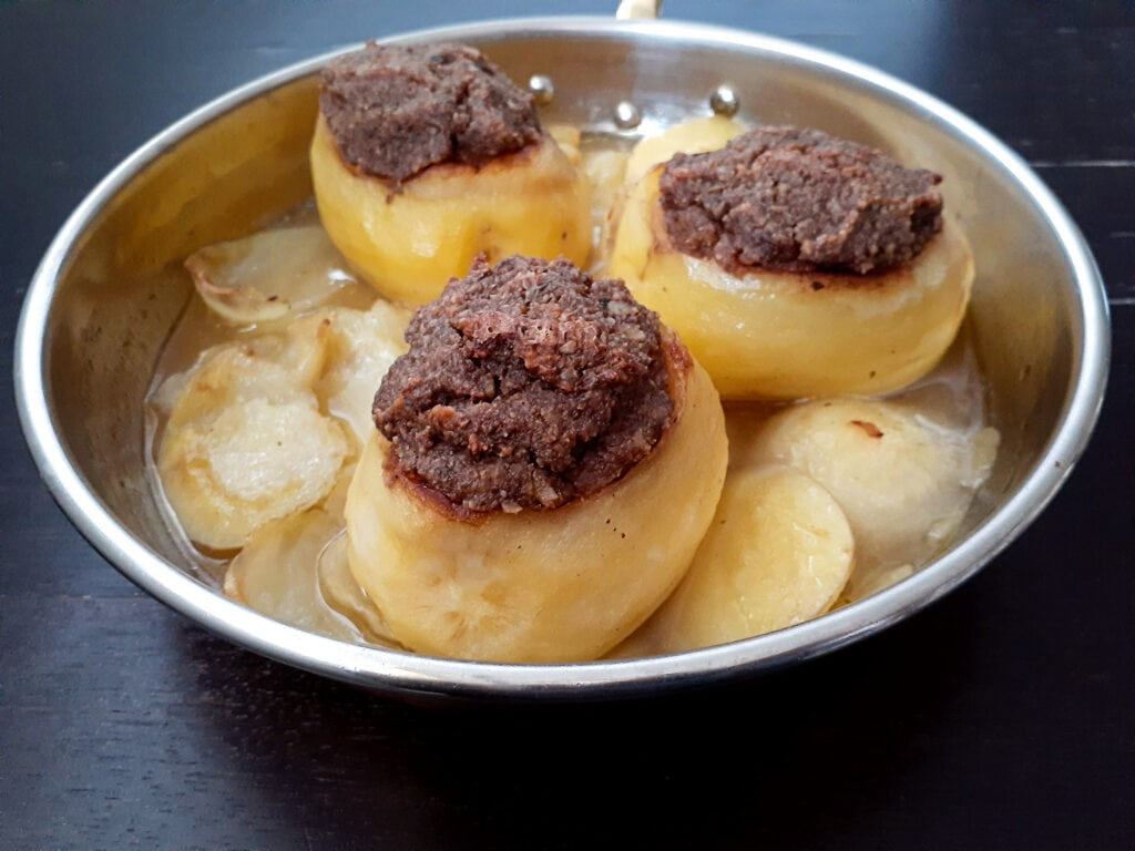 Three stuffed potatoes in a pan