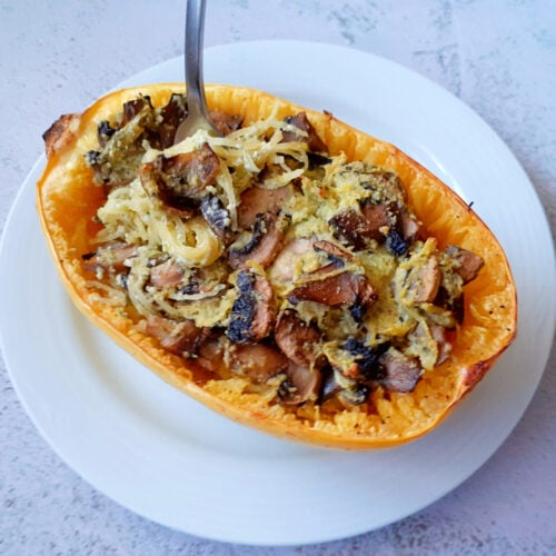 Stuffed spaghetti squash on a plate with a fork