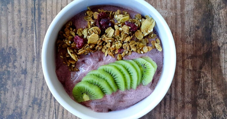 Acai bowl with matcha granola and kiwi slices