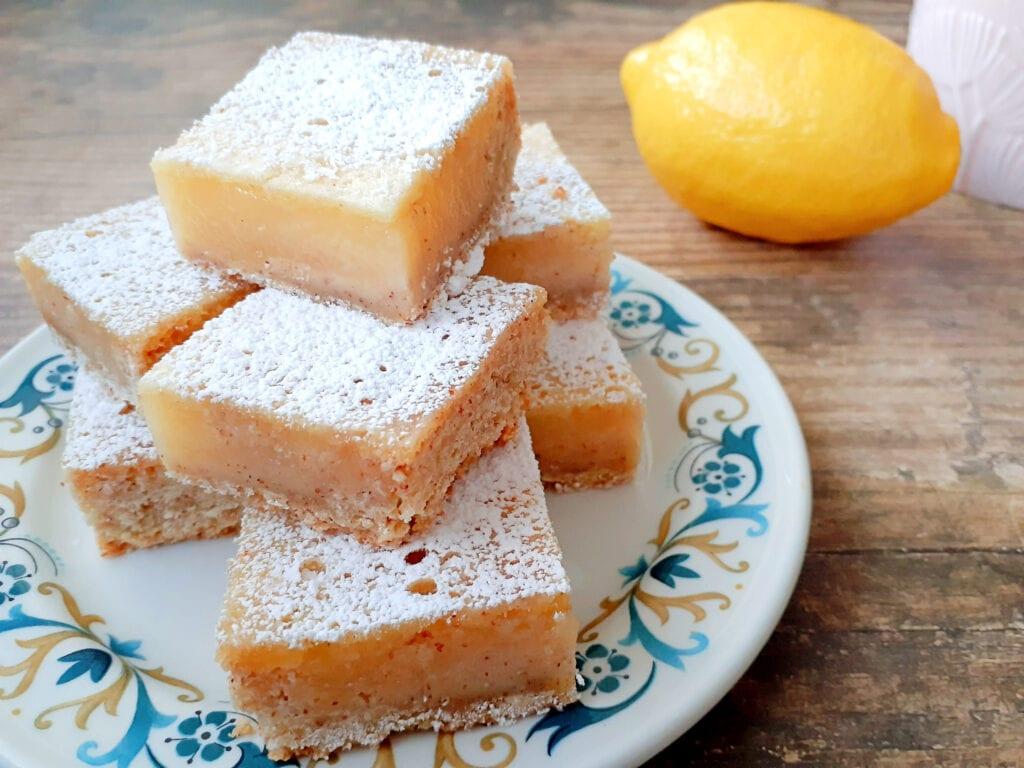 Lemon bars on a plate.