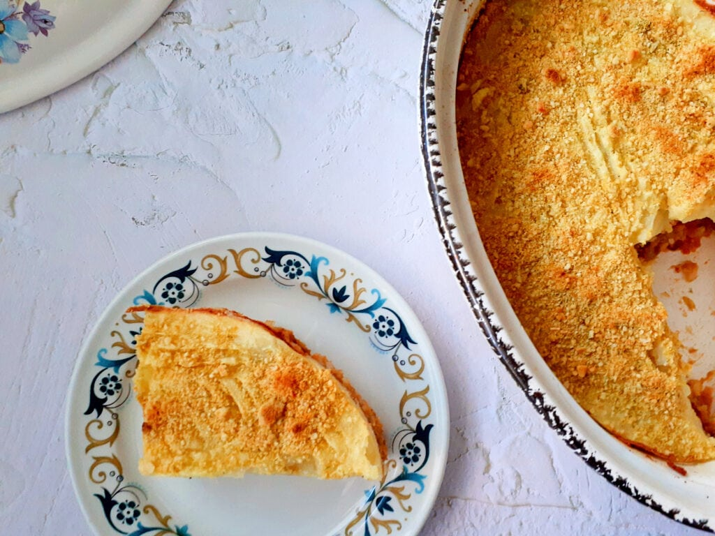 Vegan shepherd's pie on a plate, and in an oven dish