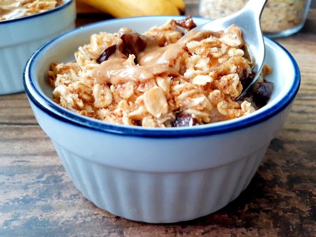 Baked oatmeal in a ramekin with a spoon