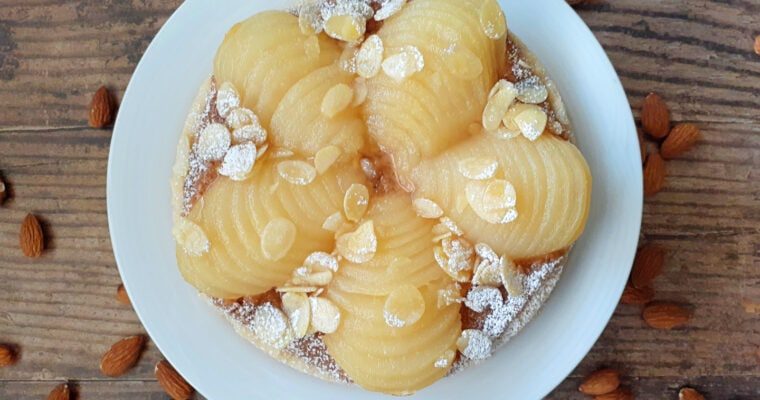 Pear and almond tart on a plate