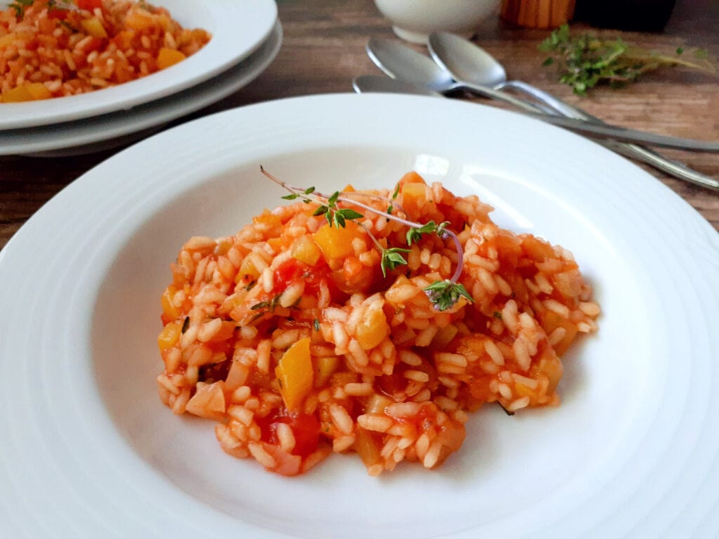 Ratatouille risotto on a plate, close up
